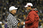 """Paul Wulff, Washington State head football coach, has a """"discussion"""" with the head referee during the Cougars Pac-10 conference """"Apple Cup"""" showdown with arch-rival Washington at Husky Stadium in Seattle, Washington, on November 28, 2009.  The Cougars lost to the Huskies in the game, 30-0."""