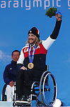 Caleb Brosseau, Sochi 2014 - Para Alpine Skiing // Para-ski alpin.<br /> Caleb Brosseau celebrates his Bronze medal win in the men's Super G sitting event // Caleb Brosseau célèbre sa médaille de bronze au Super G masculin assis. 09/03/2014.