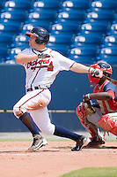 Riaan Spanjer-Furtsenburg #43 of the Rome Braves follows through on his swing against the Greenville Drive at State Mutual Stadium July 25, 2010, in Rome, Georgia.  Photo by Brian Westerholt / Four Seam Images