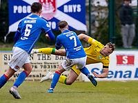 18th April 2021; Stair Park, Stranraer, Dumfries, Scotland; Scottish Cup Football, Stranraer versus Hibernian; James Hilton of Stranraer fouls Ryan Porteous of Hibernian