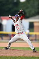 Auburn Doubledays pitcher Deion Williams (20) delivers a pitch during a game against the Batavia Muckdogs on August 31, 2014 at Dwyer Stadium in Batavia, New York.  Batavia defeated Auburn 7-6.  (Mike Janes/Four Seam Images)