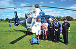 David Garwronski, Sr. David Gawronski, Jr. David, Jr's. son, along with CareFlight flight crew members Tanya Fowler, Marina Brow, and pilot Spencer Hardin, pose for a photo in front of a CareFlight medical helicopter during Sunday's WACO Fly-In event in Troy. David Gawronski, Jr. was critically injured in a car crash several years ago near Troy and stopped by to thank CareFlight crew members for their part in saving his life.
