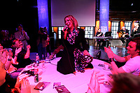 May 9 2005, Montreal (Qc) Canada <br />  Patsy Gallant gets on the table to sing at Musimax , May 9 2005 for the launch of her compilation CD.<br /> Canadian singer Gallant became an international star in the disco years with hits songs SUGAR DADDY, FROM NEW YORK TO LA, ...<br /> She also starred in movies and in Plamondon's STARMANIA in Paris during the 90's<br /> Photo : (c) 2004 Pierre Roussel