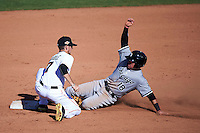 Mesa Solar Sox shortstop J.T. Riddle (7) tags out Jake Peter (18) sliding into second during an Arizona Fall League game against the Glendale Desert Dogs on October 14, 2015 at Sloan Park in Mesa, Arizona.  Glendale defeated Mesa 7-6.  (Mike Janes/Four Seam Images)