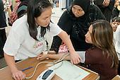 Free blood pressure check at a health stall at Church Street Summer Festival, London.