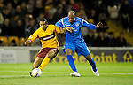Motherwell v St Johnstone...10.11.10  .Nick Blackman holds off Michael Duberry.Picture by Graeme Hart..Copyright Perthshire Picture Agency.Tel: 01738 623350  Mobile: 07990 594431