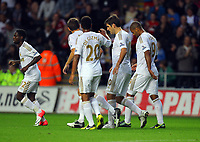Pictured: Danny Graham of Swansea (2nd R) after scoring his goal. Tuesday 28 August 2012<br /> Re: Capital One Cup game, Swansea City FC v Barnsley at the Liberty Stadium, south Wales.