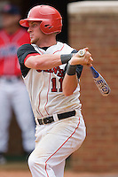 Greg Hopkins #11 of the St. John's Red Storm follows through on his swing against the Ole Miss Rebels at the Charlottesville Regional of the 2010 College World Series at Davenport Field on June 6, 2010, in Charlottesville, Virginia.  The Red Storm defeated the Rebels 20-16.  Photo by Brian Westerholt / Four Seam Images