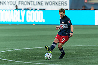 FOXBOROUGH, MA - SEPTEMBER 23: Scott Caldwell #6 of New England Revolution passes the ball during a game between Montreal Impact and New England Revolution at Gillette Stadium on September 23, 2020 in Foxborough, Massachusetts.