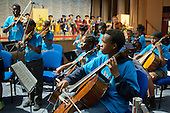 Schoolchildren from the Lambeth In Harmony project play at a ceremony during which Venezuelan composer and social visionary Maestro José Abreu is given an honorary degree by the Institute of Education, University of London, for his work with the pioneering El Sistema project.
