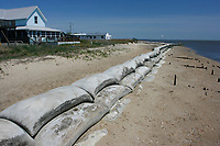 Large bags filled with hardend cement help to curb erosion caused by waves on this Delaware beach. (do)
