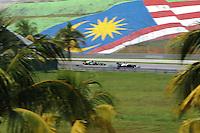 Venezuelian Pastor Maldonado on Williams Renault W34 followed by Russian Vitaly Petrov on Caterham Renault CT01.24/03/2012 Grand Prix Malesia, Sepang , Essais..Foto Insidefoto  /Bernard Asset / Panoramic.ITALY ONLY..