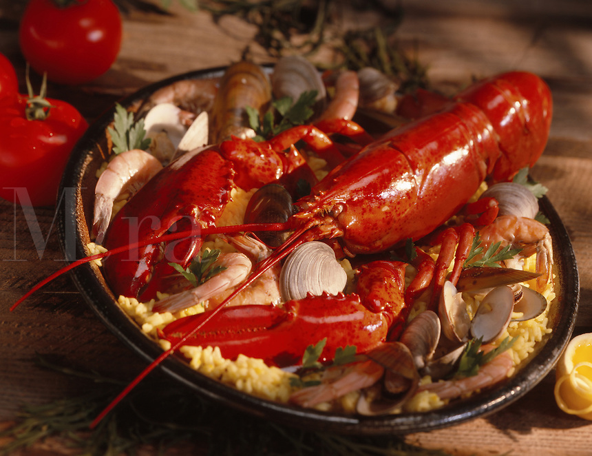 Lobster Paella with Lobster, shrimps, clams, mussels and yellow saffron rice