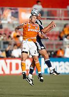 Houston Dynamo defender Wade Barrett and New York Red Bulls midfielder Markus Schopp (32) battle for a header.  Houston Dynamo defeated New York Red Bulls 4-0 at Robertson Stadium in Houston, TX on July 5, 2007.