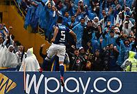 BOGOTA - COLOMBIA - 04 – 03 - 2018: Andres Cadavid (Der.), jugador de Millonarios, celebra el tercer gol anotado a America de Cali, durante partido de la fecha 6 entre Millonarios y America de Cali, por la Liga Aguila I 2018, jugado en el estadio Nemesio Camacho El Campin de la ciudad de Bogota. / Andres Cadavid (R), player of Millonarios celebrates the third scored goal to America de Cali,  during a match of the 6th date between Millonarios and America de Cali,  for the Liga Aguila I 2018 played at the Nemesio Camacho El Campin Stadium in Bogota city, Photo: VizzorImage / Luis Ramirez / Staff.