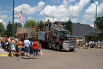 Logging truck driving in 4th of July parade.  Winter, WI