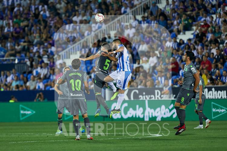 Leganes' Dimitrios Siovas and Real Sociedad's Mikel Oyarzabal (l) and Igor Zubeldia (r) during La Liga match. August 24, 2018. (ALTERPHOTOS/A. Perez Meca)