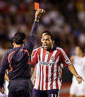 Chivas USA forward is shown a red card from referee Balomero Toledo. The LA Galaxy defeated Chivas USA 1-0 to win the final edition of the 2009 SuperClásico at Home Depot Center stadium in Carson, California on Saturday, August 29, 2009...