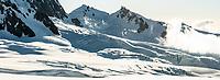 Crevasses under jugged Fox Range in upper parts of Fox Glacier NEVE, Westland Tai Poutini National Park, West Coast, UNESCO World Heritage Area, New Zealand, NZ