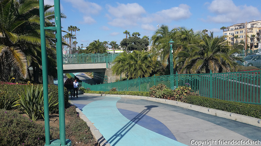 Pier View Way Undercrossing, Oceanside. Pedestrian path links City Hall to Oceanside Pier. Colorful ribbons of concrete and custom wrought-iron fence separate cyclist from pedestrians. Marian Marum, Landscape Architect.