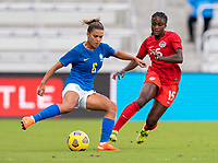 ORLANDO, FL - FEBRUARY 24: Tamires #6 of Brazil is defended by Nichelle Prince #15 of Canada during a game between Brazil and Canada at Exploria Stadium on February 24, 2021 in Orlando, Florida.