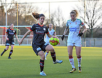 Amber De Priester (6) of Zulte-Waregem pictured in front of Tine Schryvers (23) of OHL during a female soccer game between Oud Heverlee Leuven and SV Zulte-Waregem on the 16 th matchday of the 2020 - 2021 season of Belgian Womens Super League , sunday 14 th of March 2021  in Heverlee , Belgium . PHOTO SPORTPIX.BE | SPP | DAVID CATRY
