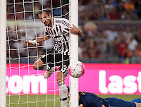 Calcio, Serie A: Roma vs Juventus. Roma, stadio Olimpico, 30 agosto 2015.<br /> Juventus' Giorgio Chiellini looks at the ball as Roma's goalkeeper Wojciech Szczesny, bottom, lies on the pitch during the Italian Serie A football match between Roma and Juventus at Rome's Olympic stadium, 30 August 2015.<br /> UPDATE IMAGES PRESS/Isabella Bonotto