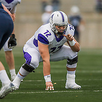 8 October 2016: Amherst College Purple & White Offensive Lineman Elijah Zabludoff, a Junior from Rancho Palos Verdes, CA, lines up against the Middlebury College Panthers at Alumni Stadium in Middlebury, Vermont. The Panthers edged out the Purple & While 27-26. Mandatory Credit: Ed Wolfstein Photo *** RAW (NEF) Image File Available ***