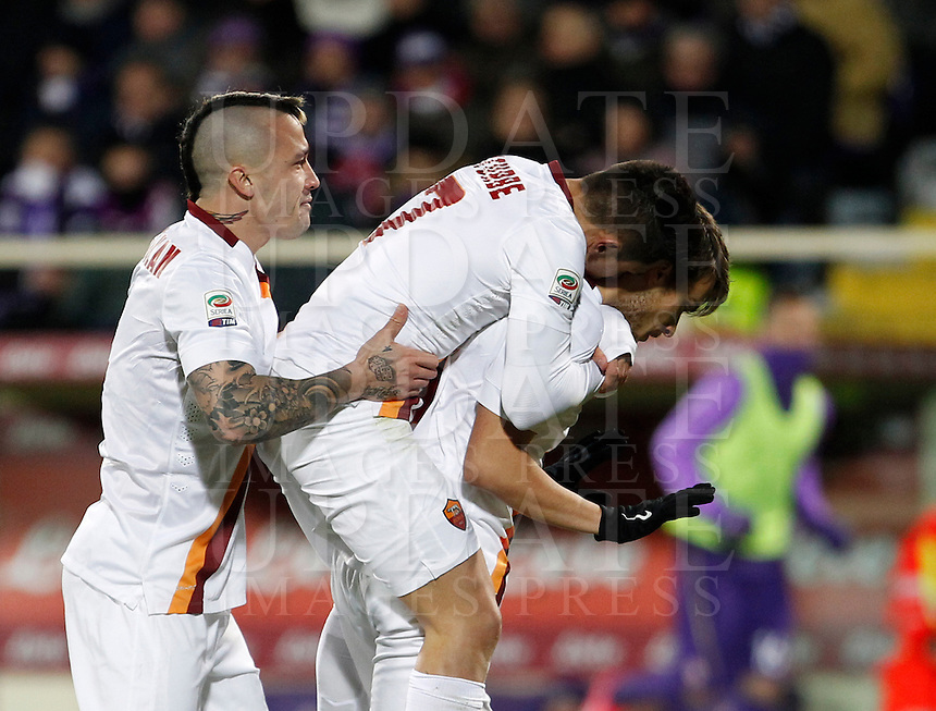 Calcio, Serie A: Fiorentina vs Roma. Firenze, stadio Artemio Franchi, 25 gennaio 2015.<br /> Roma's Adem Ljajic, right, is hugged by teammates Radja Nainggolan, left, and Juan Iturbe, after scoring during the Italian Serie A football match between Fiorentina vs Roma at Florence's Artemio Franchi stadium, 25 January 2015.<br /> UPDATE IMAGES PRESS/Isabella Bonotto
