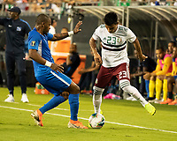 CHARLOTTE, NC - JUNE 23: Kevin Fortune #9 defends against Jesus Gallardo #23 during a game between Mexico and Martinique at Bank of America Stadium on June 23, 2019 in Charlotte, North Carolina.