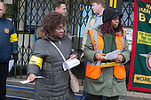 Striking RMT London Bakerloo Line staff picket Edgware Road tube station over job cuts.