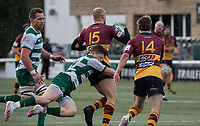 Tom Hudson of Ampthill RUFC is tackled by Angus Kernohan of Ealing Trailfinders during the Greene King IPA Championship match between Ealing Trailfinders and Ampthill RUFC being played behind closed doors due to the COVID-19 pandemic restrictions at Castle Bar , West Ealing , England  on 13 March 2021. Photo by Alan Stanford / PRiME Media Images