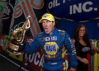 Aug. 18, 2013; Brainerd, MN, USA: NHRA funny car driver Ron Capps celebrates after winning the Lucas Oil Nationals at Brainerd International Raceway. Mandatory Credit: Mark J. Rebilas-