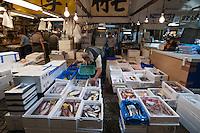 Overview of a wholesale fish stall at Tsukiji Market, Tokyo, Japan.