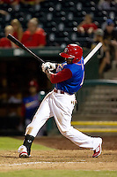 Daryl Jones (4) of the Springfield Cardinals follows through his swing during a game against the Corpus Christi Hooks at Hammons Field on August 13, 2011 in Springfield, Missouri. Springfield defeated Corpus Christi 8-7. (David Welker / Four Seam Images)