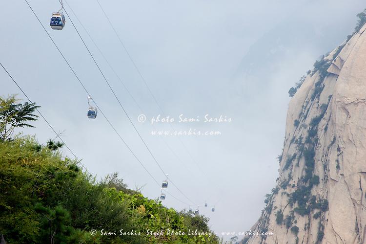 Cable cars carrying passengers to the peak of Hua Shan Xian Shaanxi China. Sami Sarkis