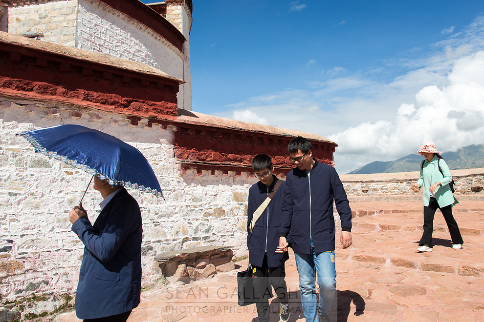 Tourists in the Potala Palace in Lhasa. One of the spiritual centers of Tibet, it is also the number one tourist sight in the city leading to thousands of tourists and pilgrims visiting each day. Most walk clockwise around the palace, pausing to pray, or take pictures, of the sacred structure before them.