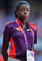 August 05, 2012: A volunteer during athletic competition at the Olympic Stadium on day nine of 2012 Olympic Games in London, United Kingdom.