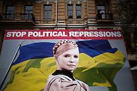"""UKRAINE, Kiev, 2/06/2012.Une affiche montrant l'opposante politique Ioulia Timochenko lisant """"Stop aux répressions politiques"""" est placardée dans le centre de Kiev, Ukraine. Ioulia Timochenko a été condamnée, le 11 octobre 2011 à sept ans d'emprisonnement pour abus de pouvoir dans le cadre de contrats gaziers signés avec la Russie en 2009, alors qu'elle exerçait la fonction de chef du gouvernement..UKRAINE, Kiev, 2012/06/2..A sign showing opposition politician Yulia Tymoshenko reading """"Stop Political Repression"""" is posted in the center of Kiev, Ukraine. Tymoshenko was sentenced October 11, 2011 seven years in prison for abuse of power through gas contract signed with Russia in 2009, when she held the position of head of government..© Pierre Marsaut / Est&Ost Photography"""