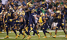 Sept 13, 2014; Cornerback Devin Butler celebrates with teammates after making an interception against Purdue in the Shamrock Series football game at Lucas Oil Stadium in Indianapolis. (Photo by Barbara Johnston/University of Notre Dame)