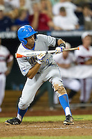UCLA outfielder Brian Carroll (24) squares to bunt against the North Carolina State Wolfpack during Game 8 of the 2013 Men's College World Series on June 18, 2013 at TD Ameritrade Park in Omaha, Nebraska. The Bruins defeated the Wolfpack 2-1, eliminating North Carolina State from the tournament. (Andrew Woolley/Four Seam Images)