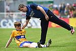 Dermot Coughlan, captain of Clare, is consoled by Paul Dunne, Strength and Conditioning coach following their Minor Munster final at Killarney.  Photograph by John Kelly.