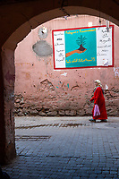 Marrakesh, Morocco.  Medina Street Scene, Poster Urging Protection of the Environment.
