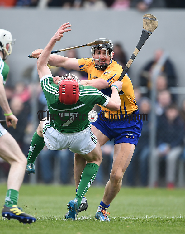 John Conlon of Clare in action against Seamus Hickey of Limerick during their Div. 1b Round 5 game in Cusack park. Photograph by John Kelly.
