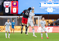 WASHINGTON, DC - MAY 13: Adrien Perez #16 of D.C. United goes up for a header with Boris Sekulic #2 of Chicago Fire FC during a game between Chicago Fire FC and D.C. United at Audi FIeld on May 13, 2021 in Washington, DC.
