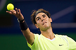 SHANGHAI, CHINA - OCTOBER 13:  Rafael Nadal of Spain serves to Stanislas Wawrinka of Switzerland during day three of the 2010 Shanghai Rolex Masters at the Shanghai Qi Zhong Tennis Center on October 13, 2010 in Shanghai, China.  (Photo by Victor Fraile/The Power of Sport Images) *** Local Caption *** Rafael Nadal