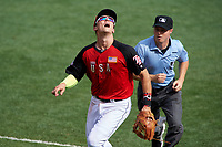 Team USA third baseman Richie Shaffer (8) tracks a foul ball popup in front of umpire Junior Valentine during the MLB All-Star Futures Game on July 12, 2015 at Great American Ball Park in Cincinnati, Ohio.  (Mike Janes/Four Seam Images)