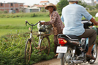 Battambang - Cambodia - June 2020<br /> Old woman on bicycle