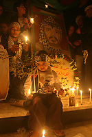 "Palestinian children hold candles and posters of the late Palestinian leader Yasser Arafat during a ceremony marking the third anniversary of his death in Gaza City, Sunday, Nov. 11, 2007. Arafat died in a Paris hospital on Nov. 11, 2004. ""Fady Adwan"""