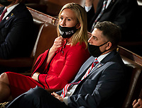 """United States Representative Marjorie Taylor Greene (Republican of Georgia) waits to be sworn in on the opening day of the 117th Congress with her mask that says """"Trump won"""" pulled below her nose at the U.S. Capitol in Washington, DC on January 03, 2021.<br /> CAP/MPI/RS<br /> ©RS/MPI/Capital Pictures"""